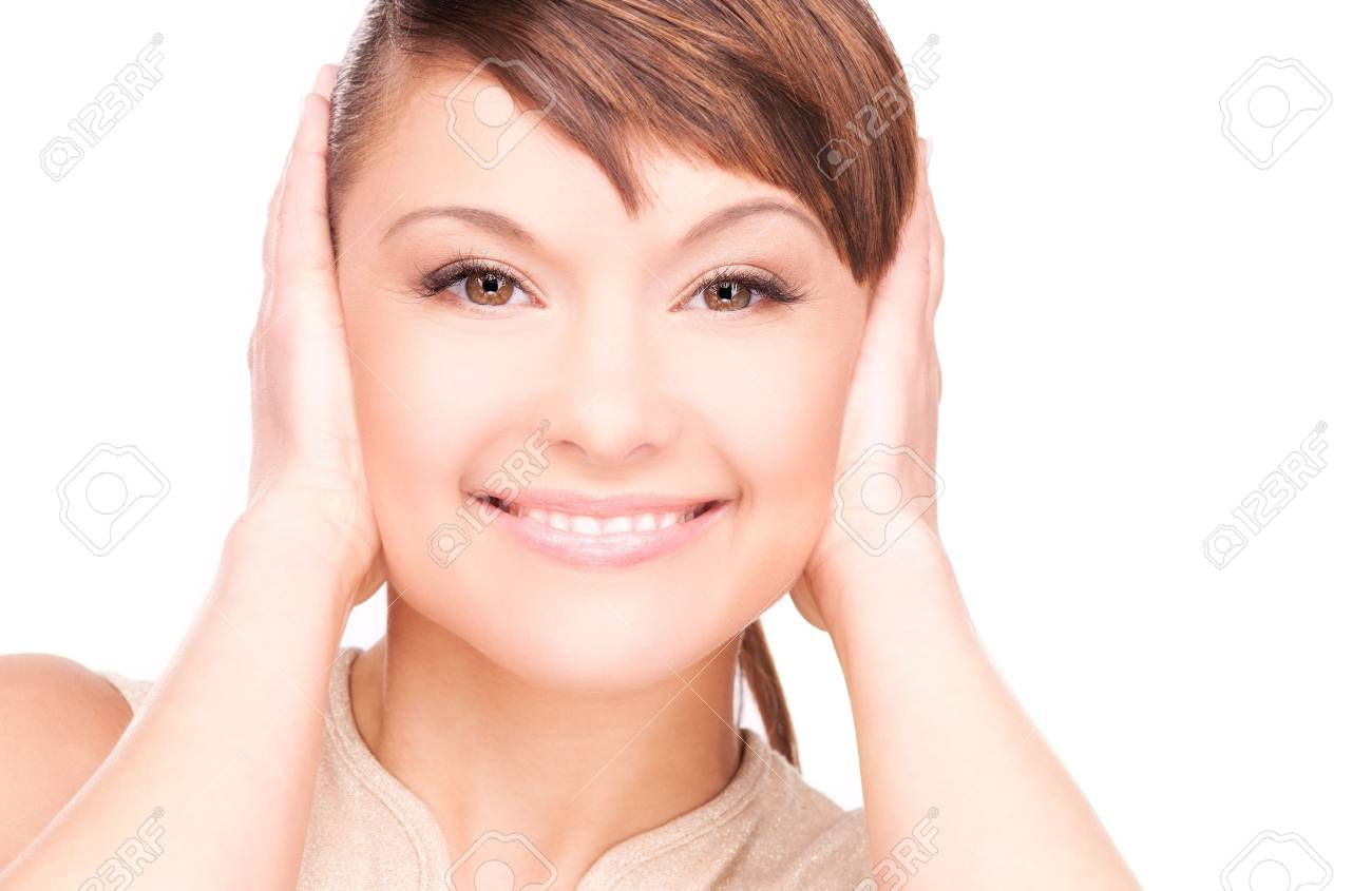 picture of smiling woman with hands over ears Stock Photo - 6760575