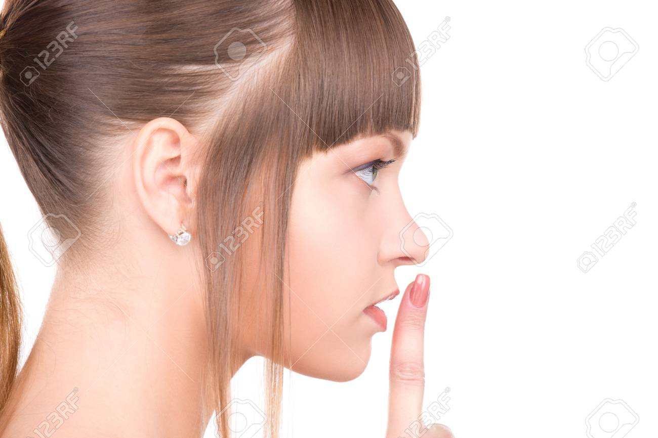 bright picture of young woman with finger on lips Stock Photo - 6806026