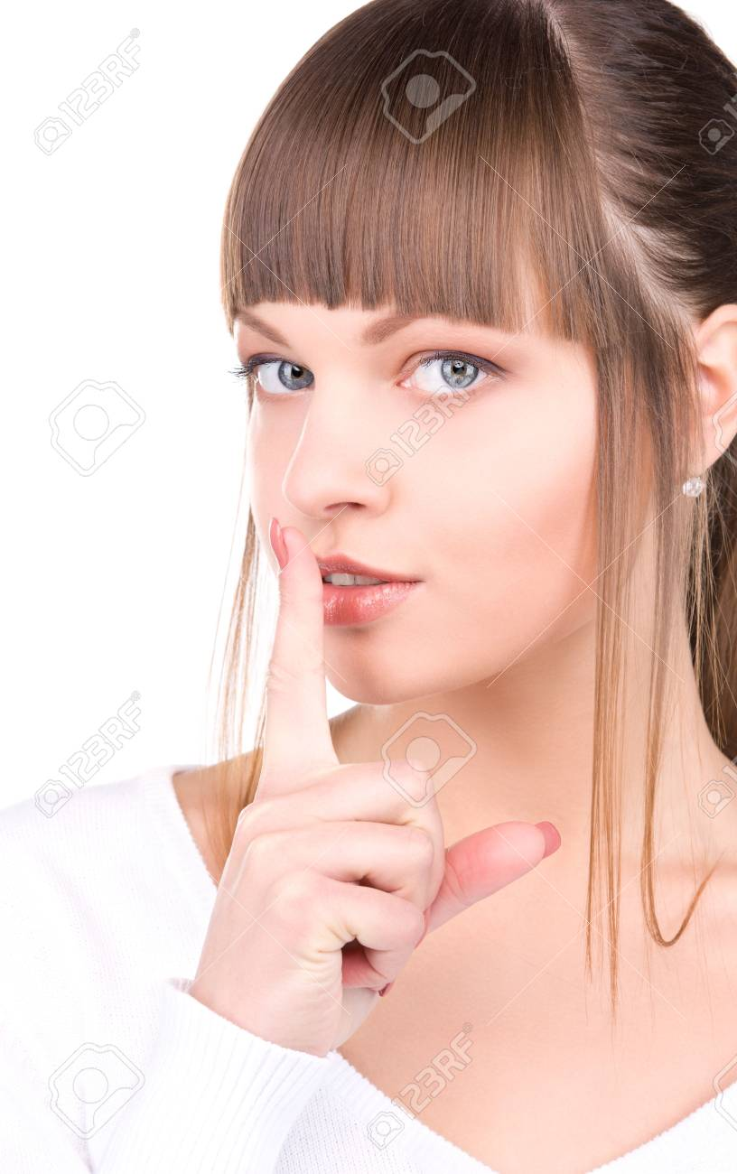 bright picture of young woman with finger on lips Stock Photo - 6806309