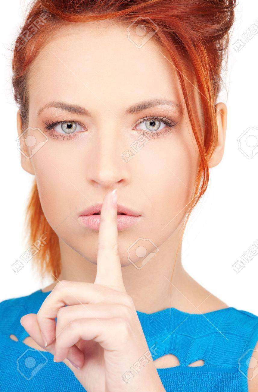 bright picture of young woman with finger on lips Stock Photo - 6806295