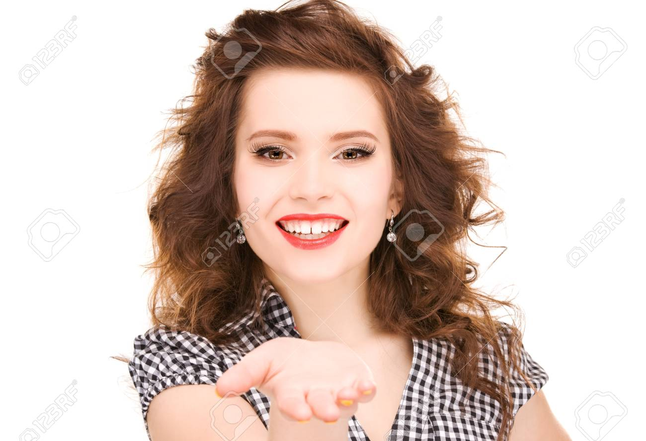 beautiful woman showing something on the palm of her hand Stock Photo - 6861687