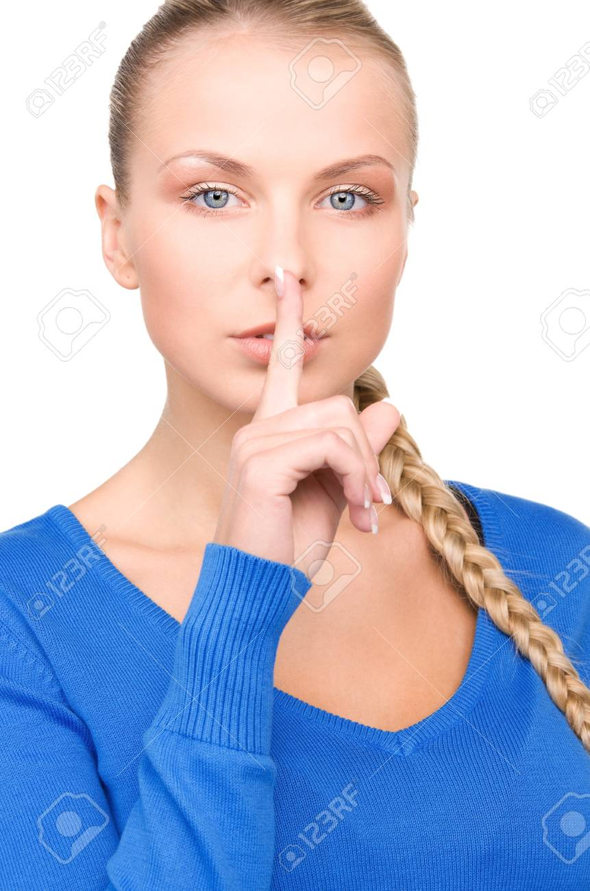 bright picture of teenage girl with finger on lips Stock Photo - 7098224