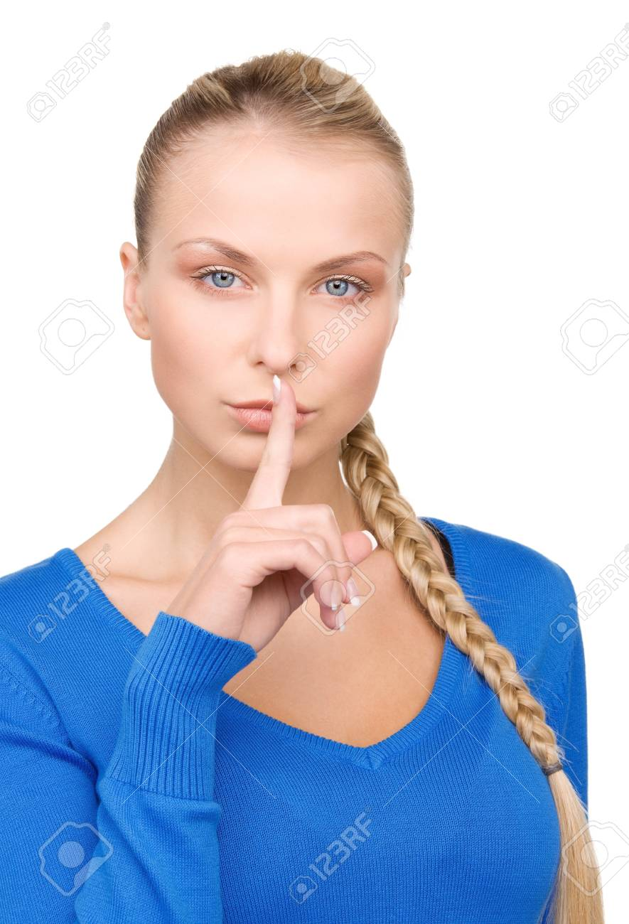 bright picture of teenage girl with finger on lips Stock Photo - 7149884