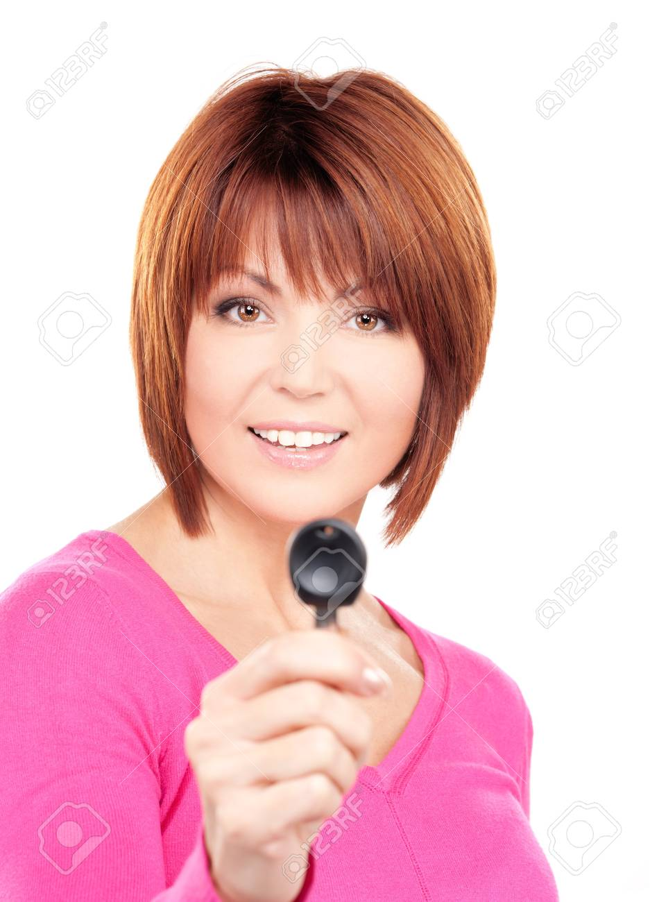 picture of happy woman with car key over white Stock Photo - 7149840