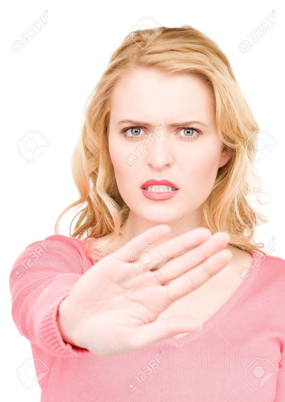 bright picture of young woman making stop gesture Stock Photo - 7280234