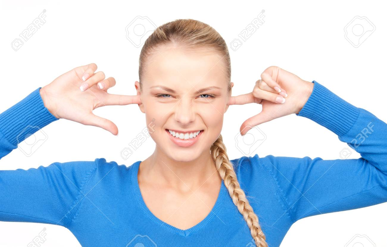 picture of smiling woman with fingers in ears Stock Photo - 7372713