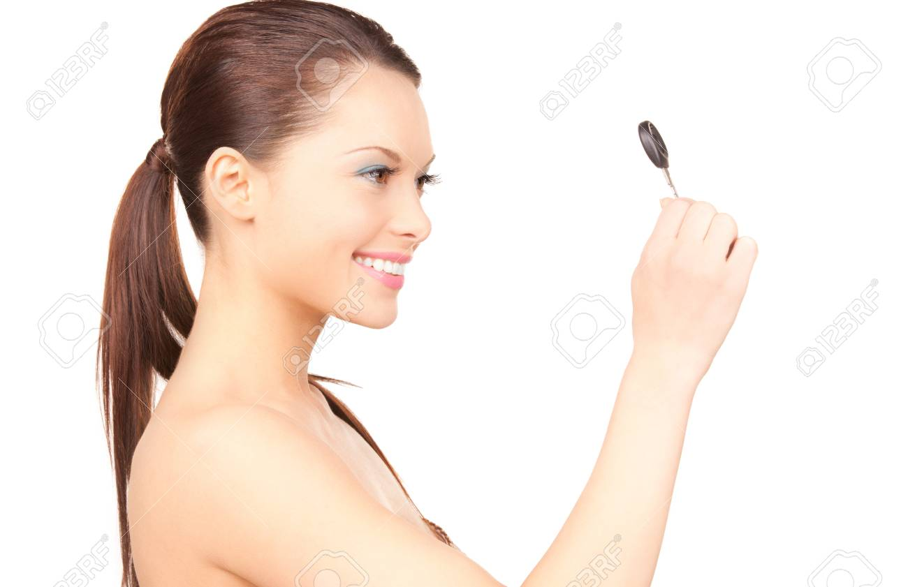 picture of happy woman with car key over white Stock Photo - 7372674