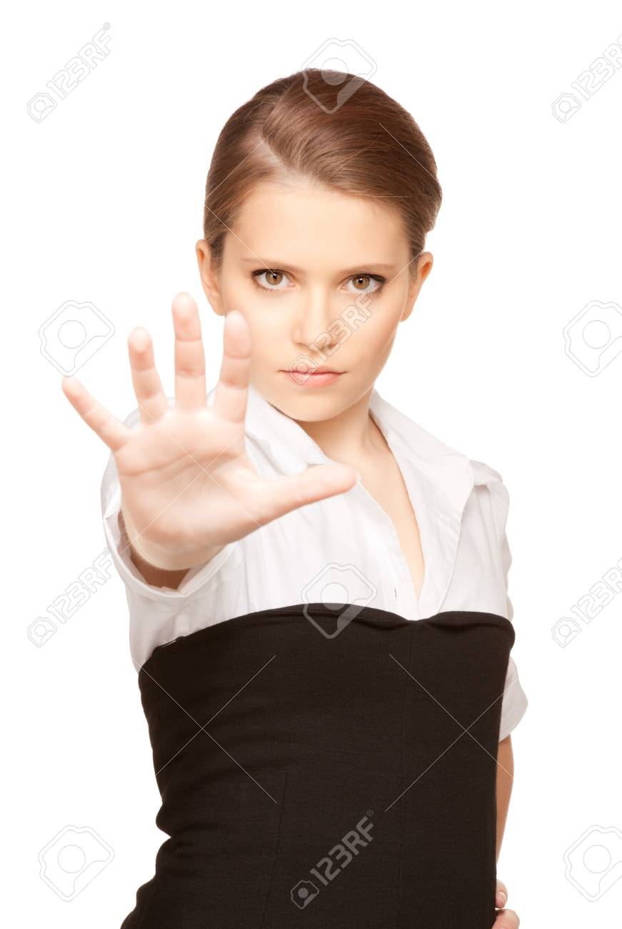 bright picture of young woman making stop gesture Stock Photo - 7418811