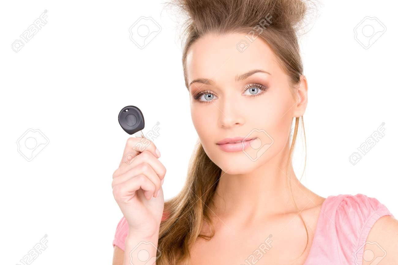 picture of happy woman with car key over white Stock Photo - 7418856