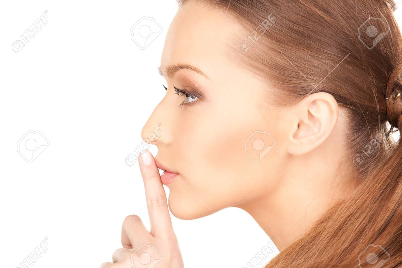 bright picture of young woman with finger on lips Stock Photo - 7497567