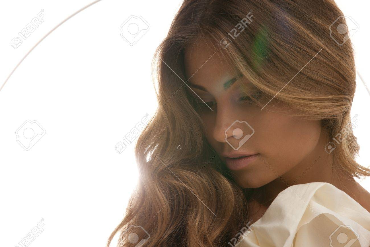 soft focus backlight picture of beautiful woman with green lens flare Stock Photo - 7595226