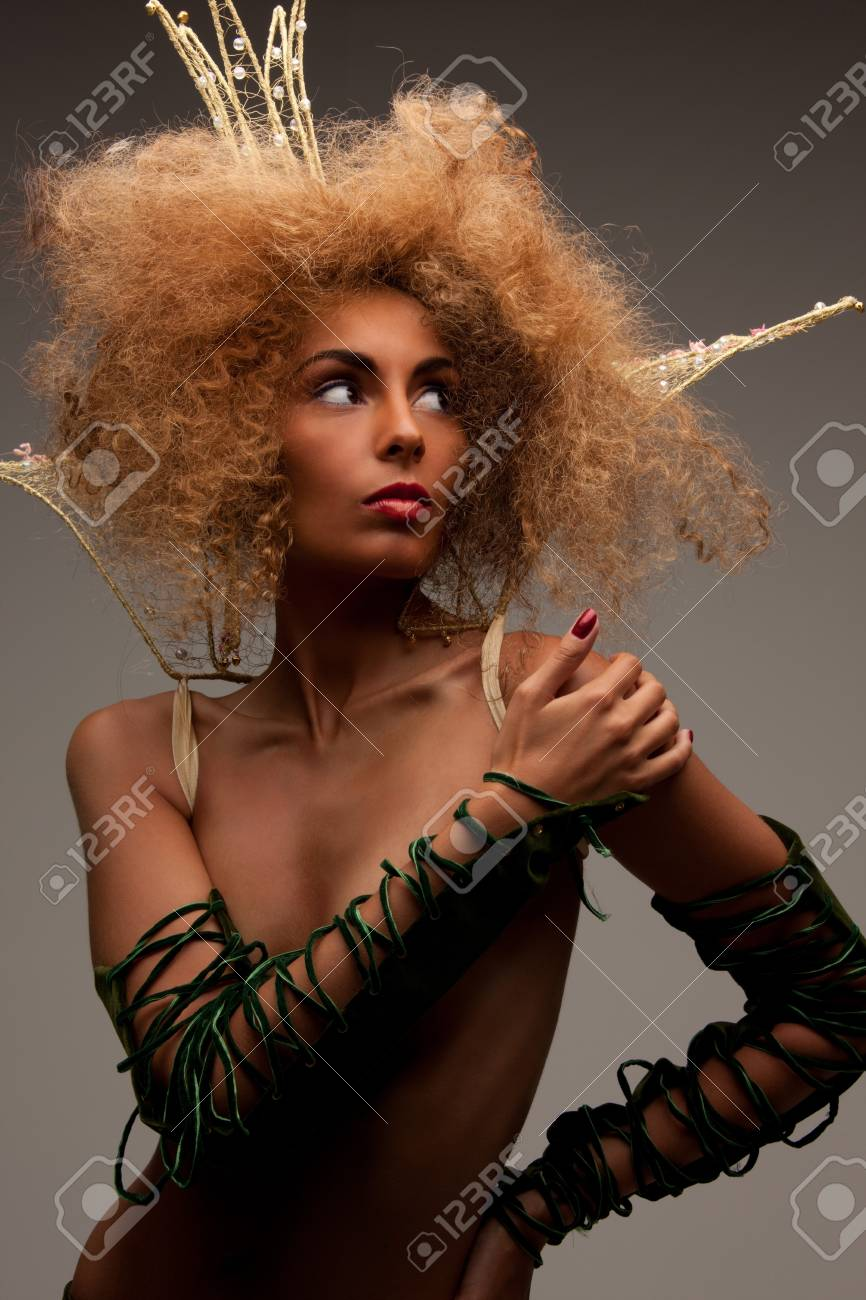 lovely woman in crown with fashionable hair over grey Stock Photo - 7595275