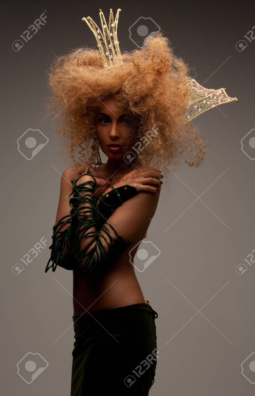 lovely woman in crown with fashionable hair over grey Stock Photo - 8072513
