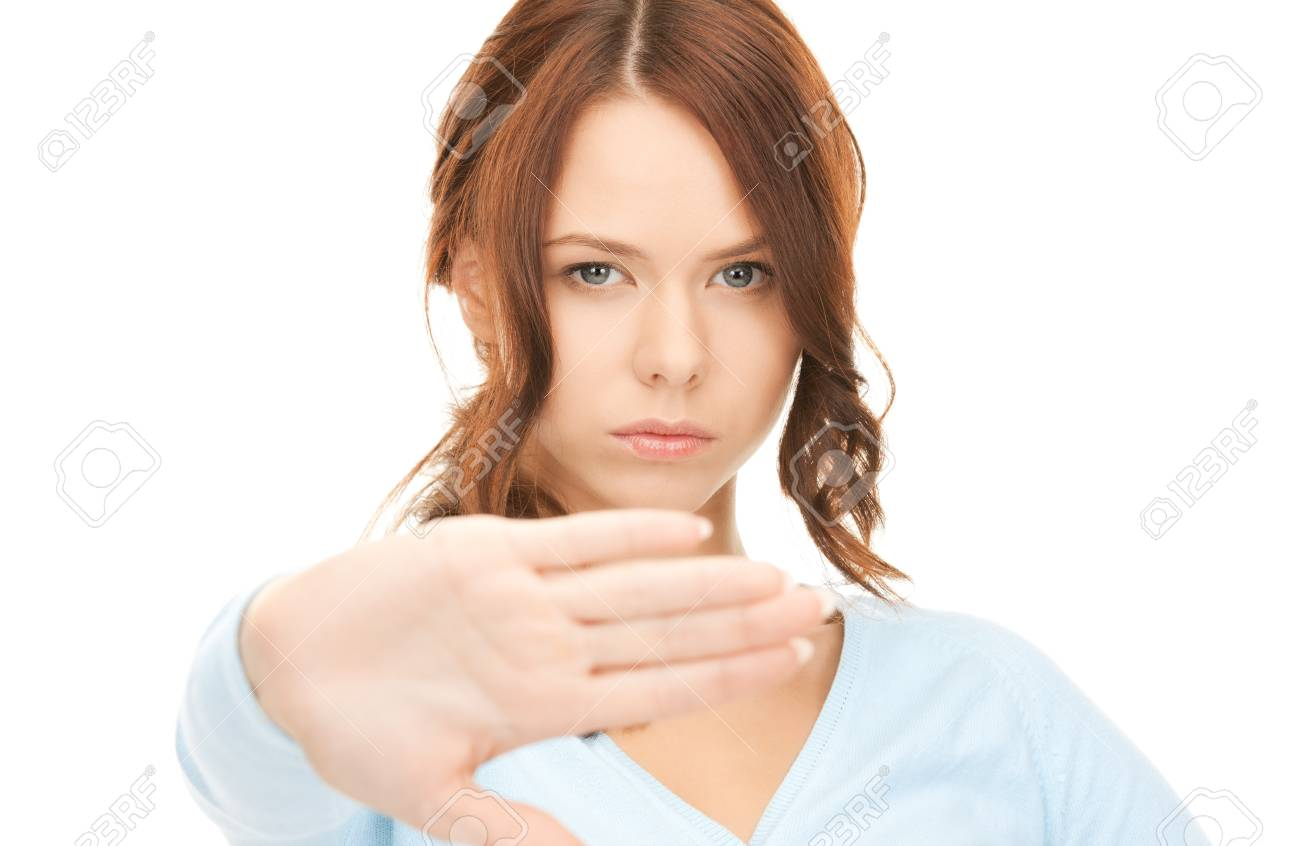 bright picture of young woman making stop gesture Stock Photo - 8072499