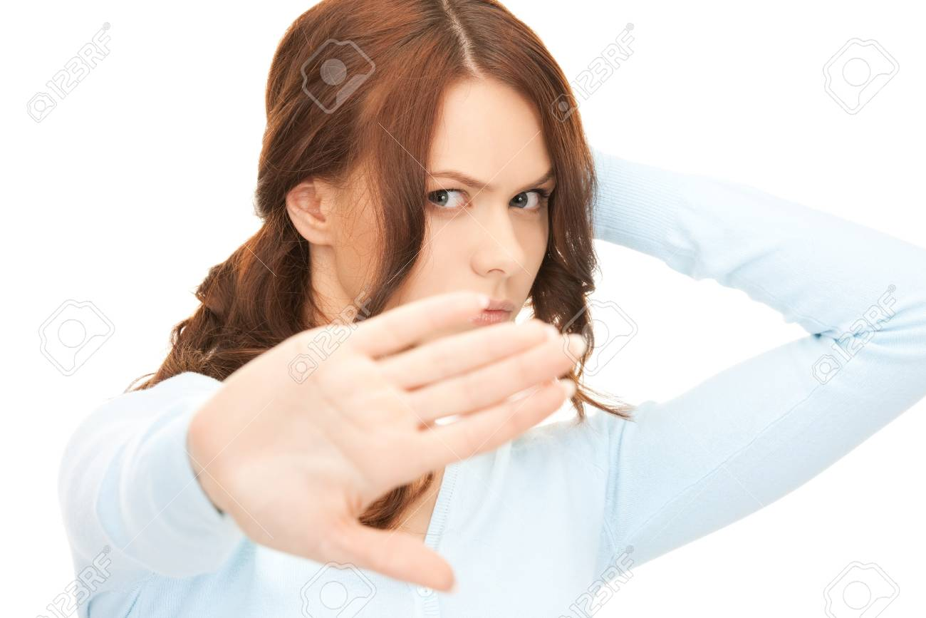 bright picture of young woman making stop gesture Stock Photo - 8276899