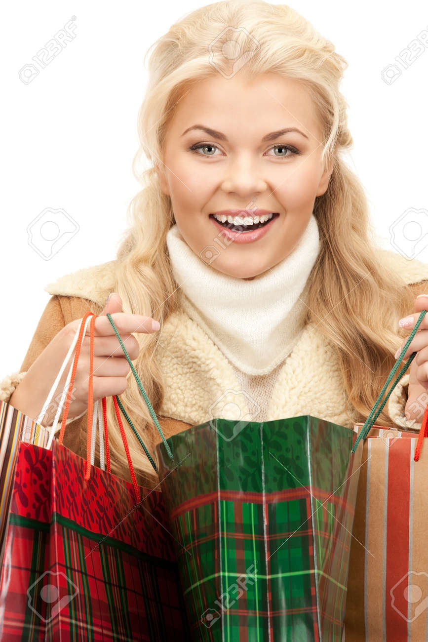 lovely woman with shopping bags over white Stock Photo - 8277236
