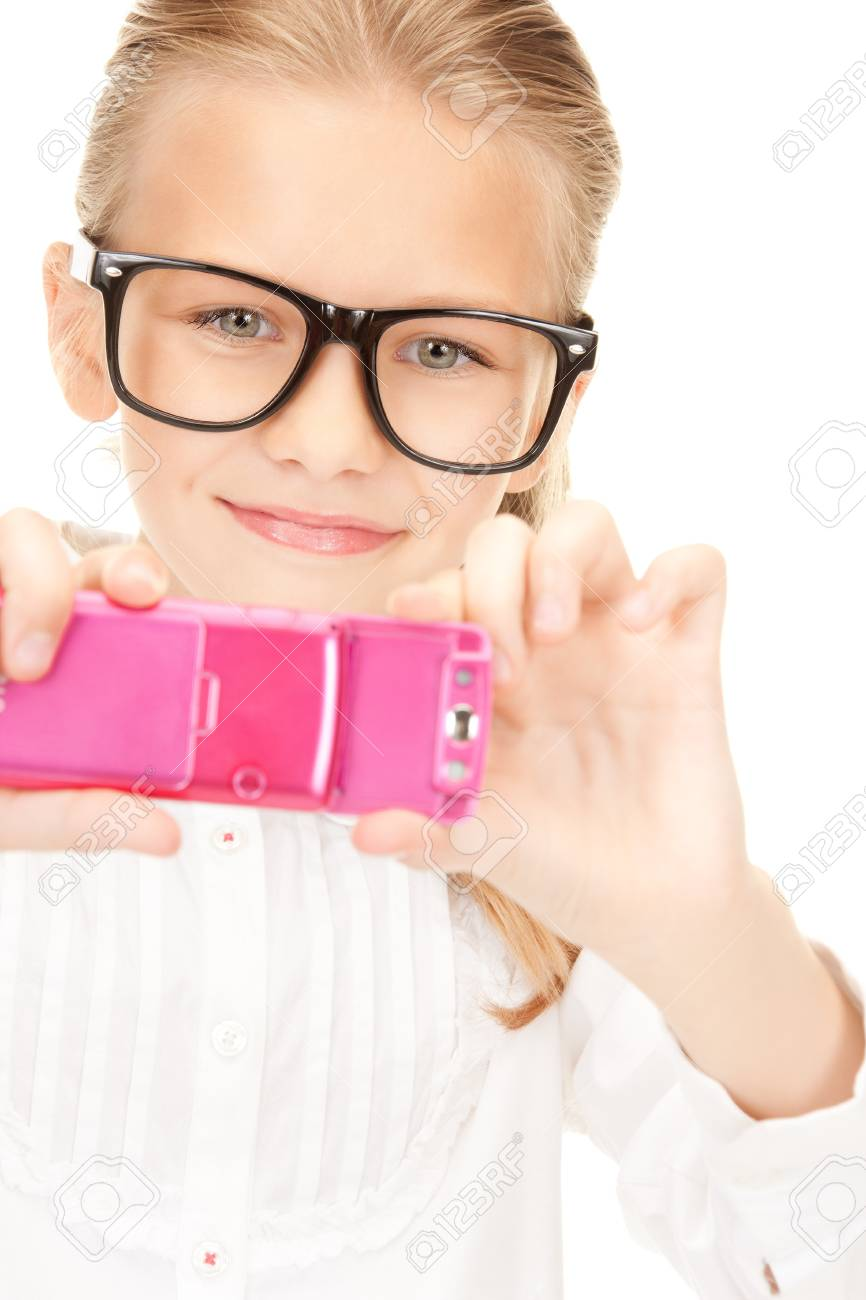 portrait of happy girl taking picture with cell phone Stock Photo - 8325059