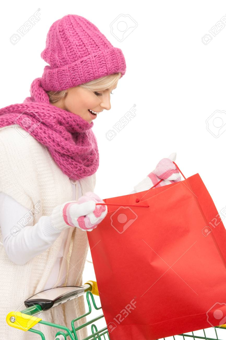 lovely woman with shopping cart over white Stock Photo - 8324404