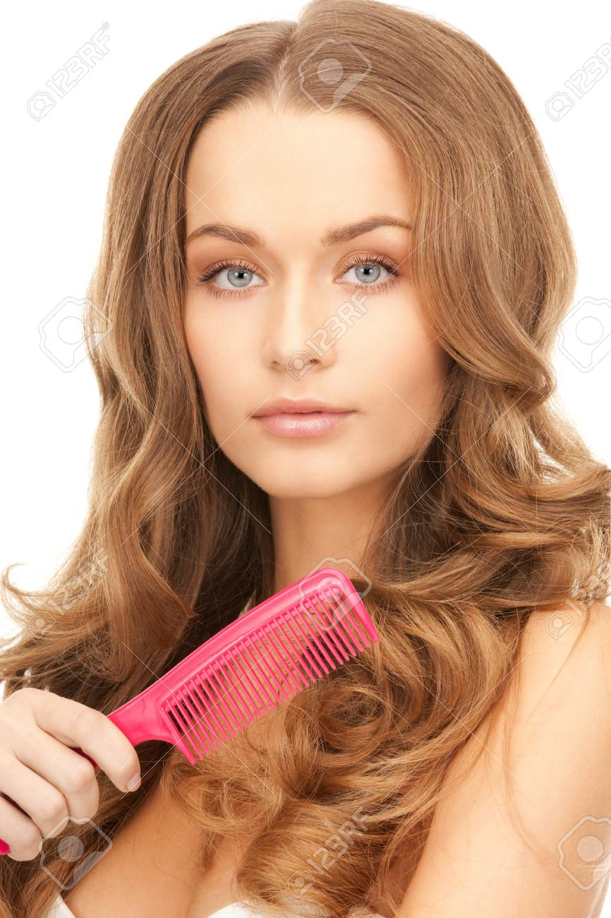 bright picture of beautiful woman with comb Stock Photo - 8410951