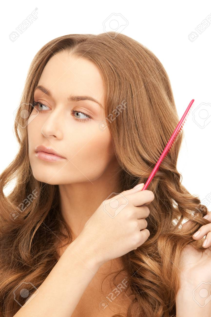 bright picture of beautiful woman with comb Stock Photo - 8740437