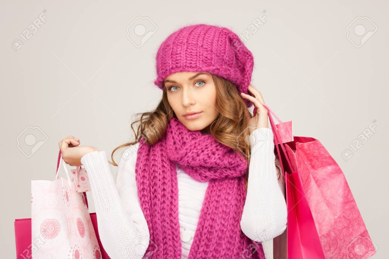 lovely woman with shopping bags over white Stock Photo - 8740734