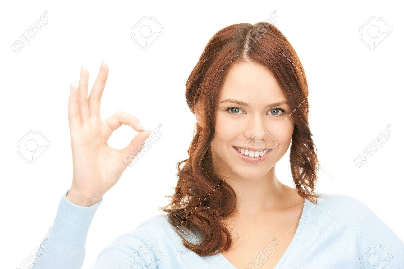 bright picture of lovely woman showing ok sign Stock Photo - 8862121