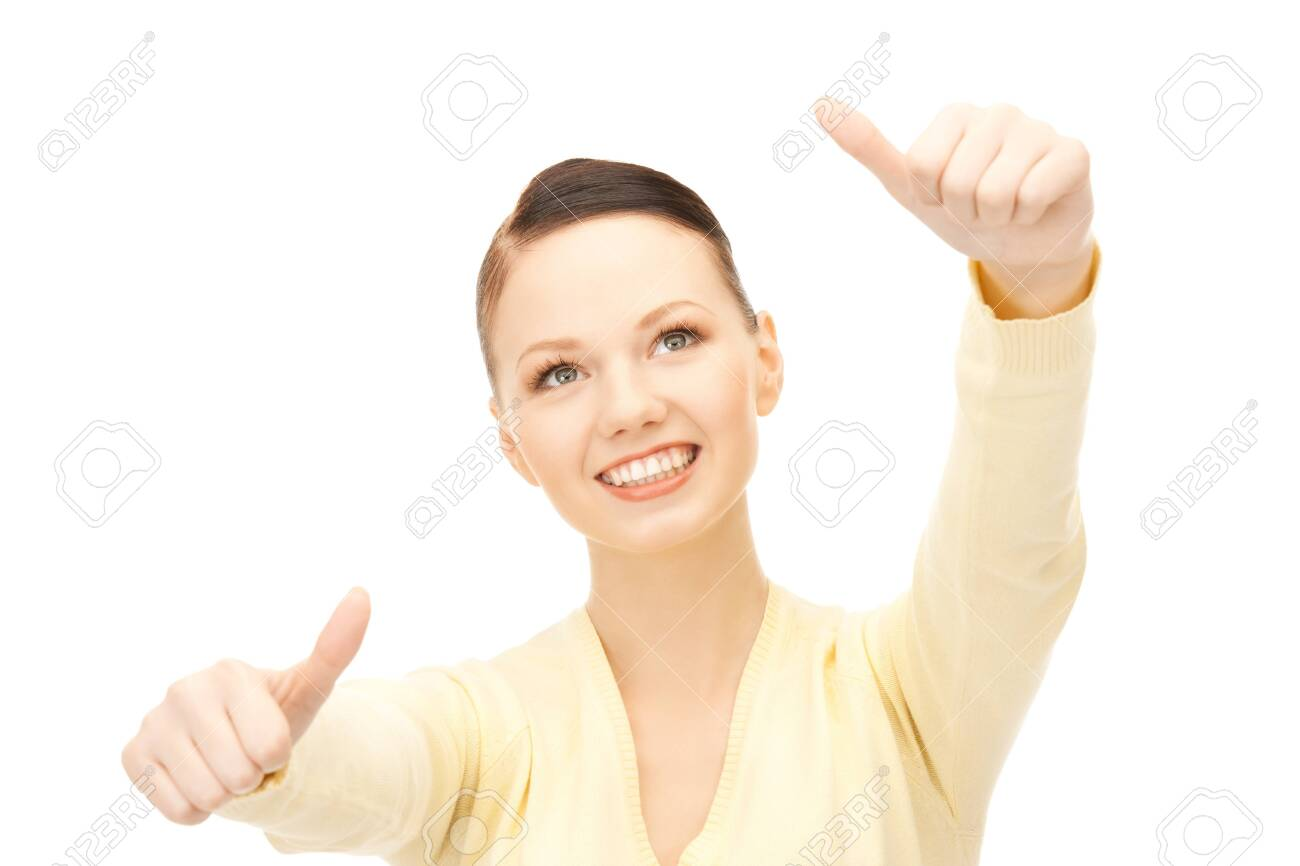 bright picture of lovely teenage girl with thumbs up Stock Photo - 8867350