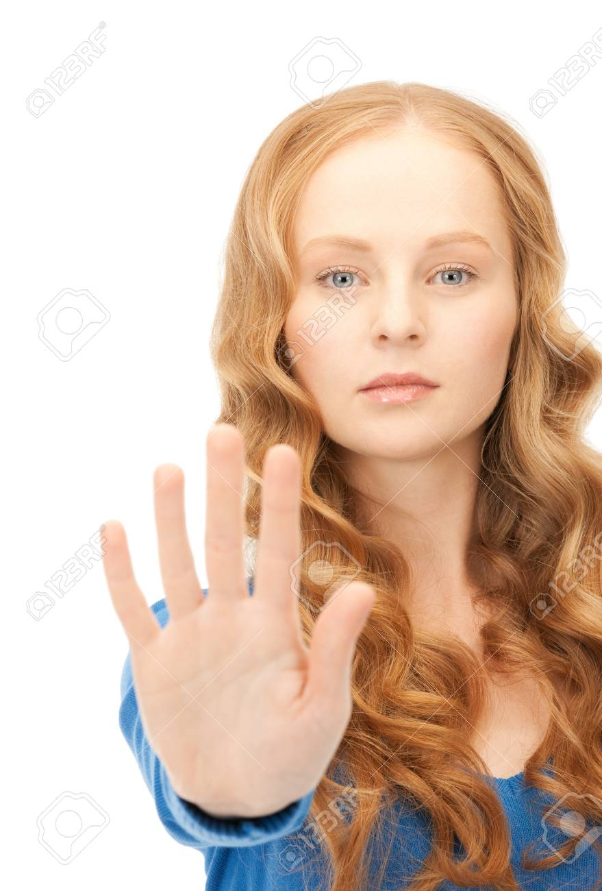 bright picture of young woman making stop gesture Stock Photo - 8981636