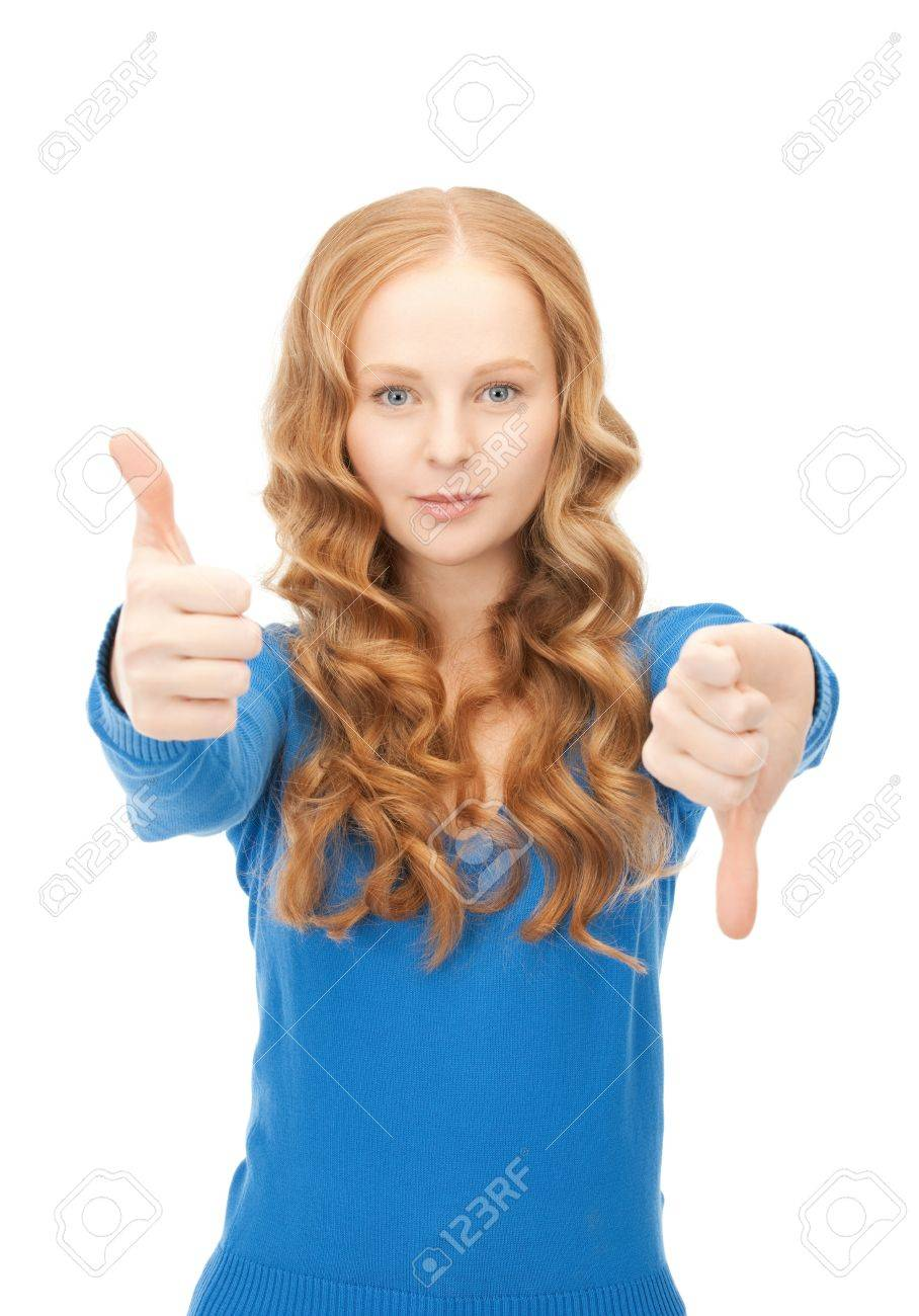 bright picture of lovely teenage girl with thumbs up and thumbs down Stock Photo - 9050352