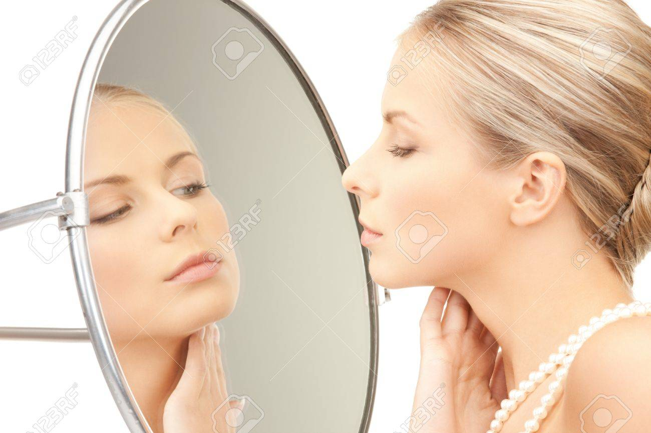 picture of beautiful woman with pearl beads and mirror Stock Photo - 9193125
