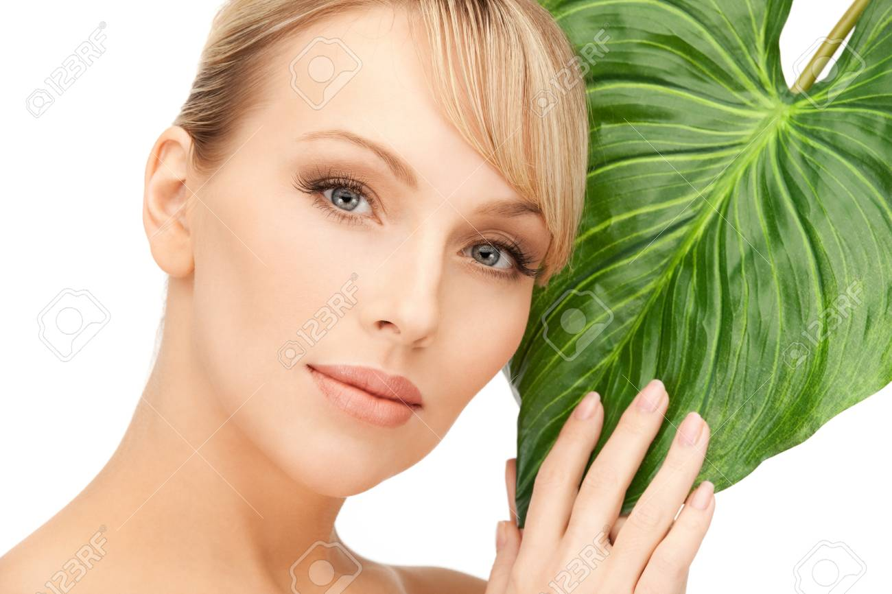 picture of woman with green leaf over white Stock Photo - 9193258