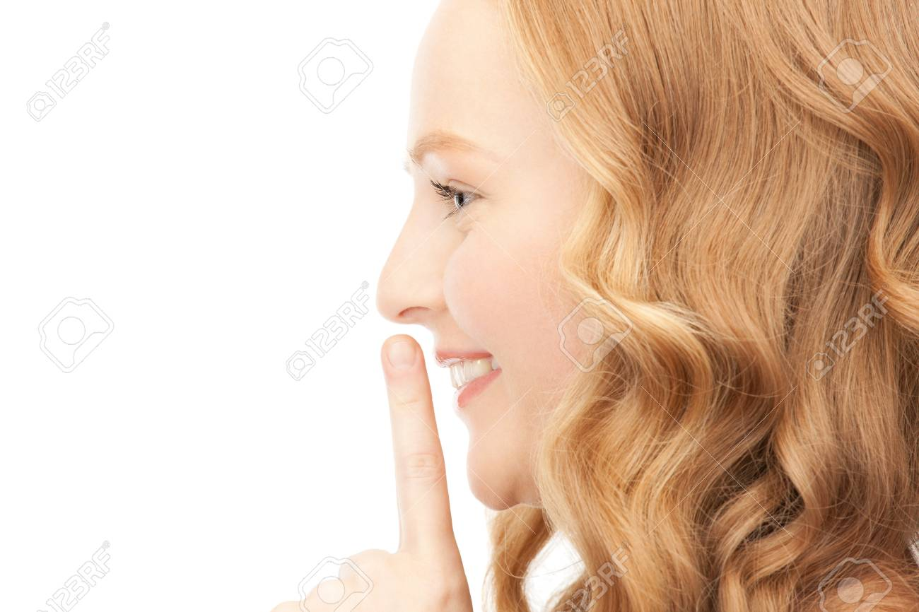 bright picture of young woman with finger on lips Stock Photo - 9234225