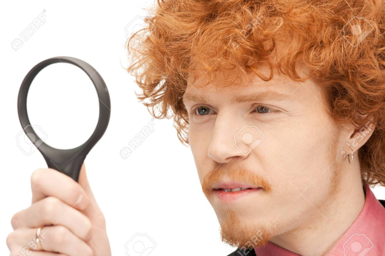 picture of handsome man with magnifying glass Stock Photo - 9354568