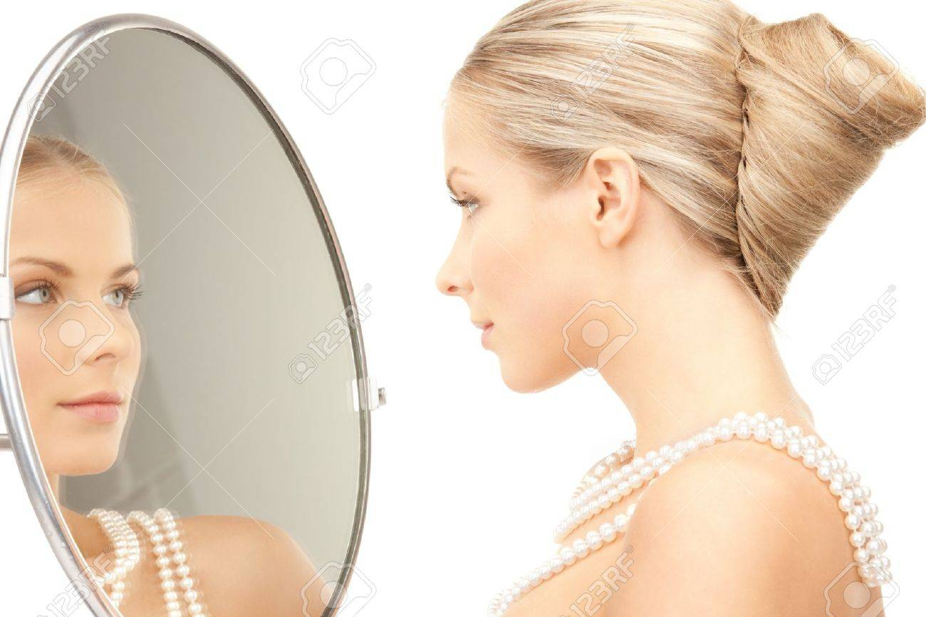 picture of beautiful woman with pearl beads and mirror Stock Photo - 9361602