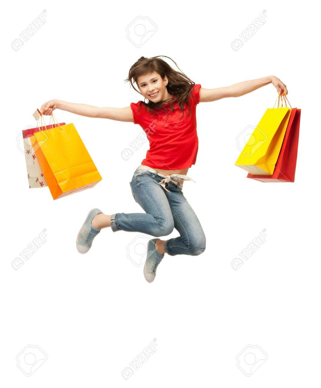 picture of jumping teenage girl with shopping bags Stock Photo - 9709429