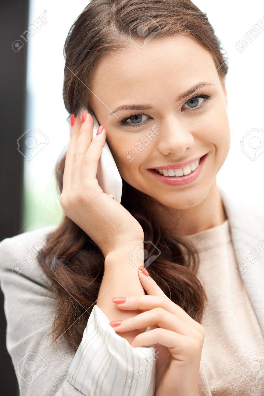 bright picture of businesswoman with cell phone Stock Photo - 10597200