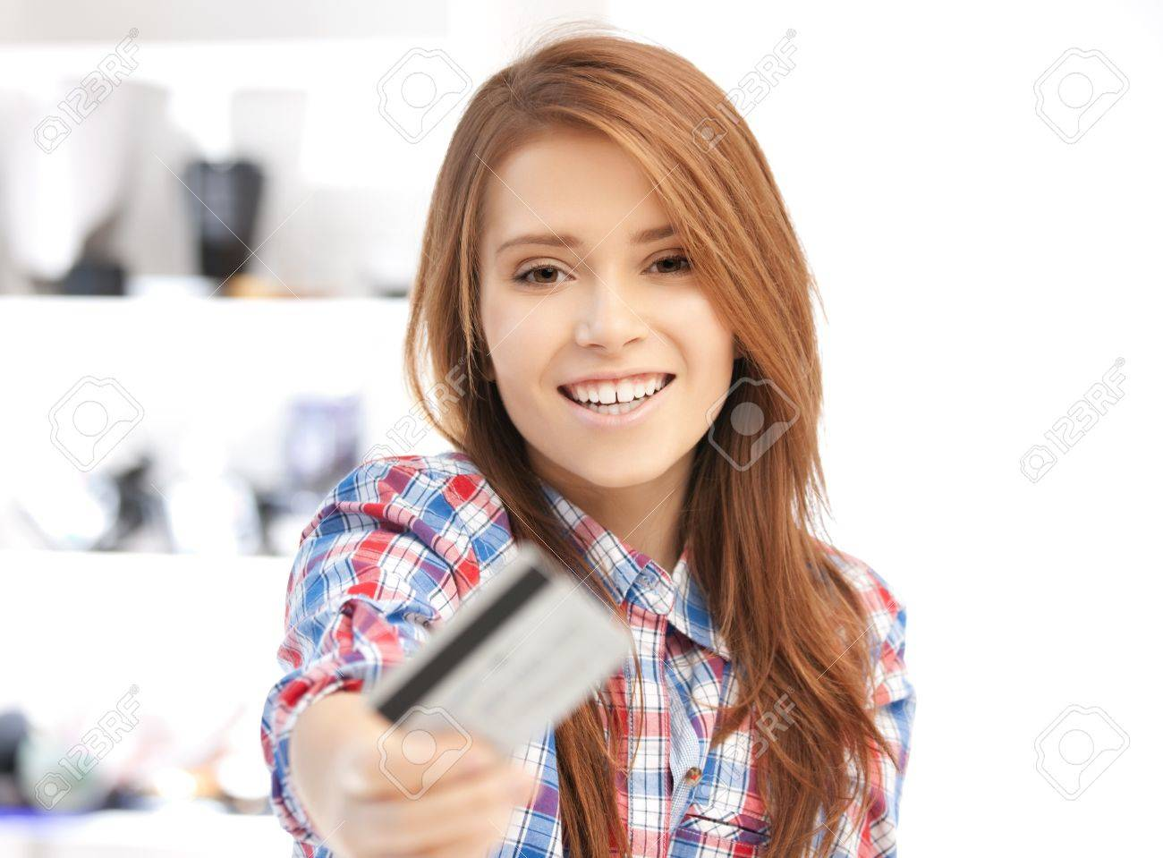 bright picture of happy woman with credit card Stock Photo - 12178727