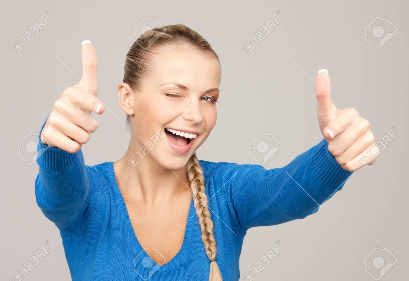 bright picture of lovely teenage girl with thumbs up Stock Photo - 12883688