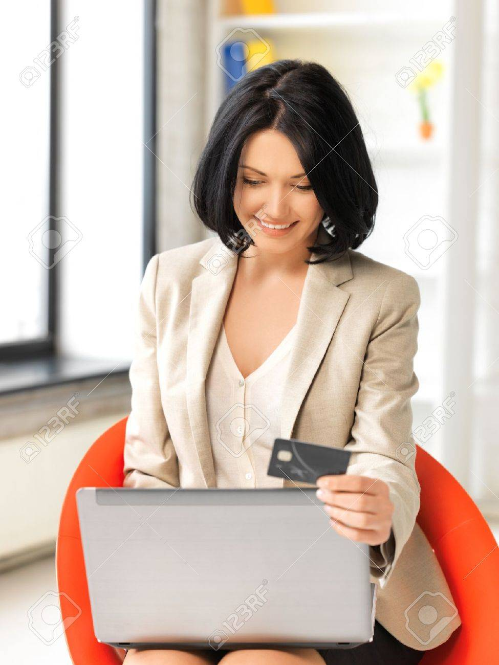 picture of happy woman with laptop computer and credit card Stock Photo - 13582378