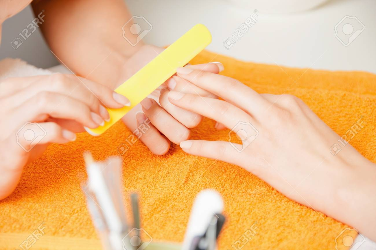 closeup picture of manicure process on female hands Stock Photo - 14313100