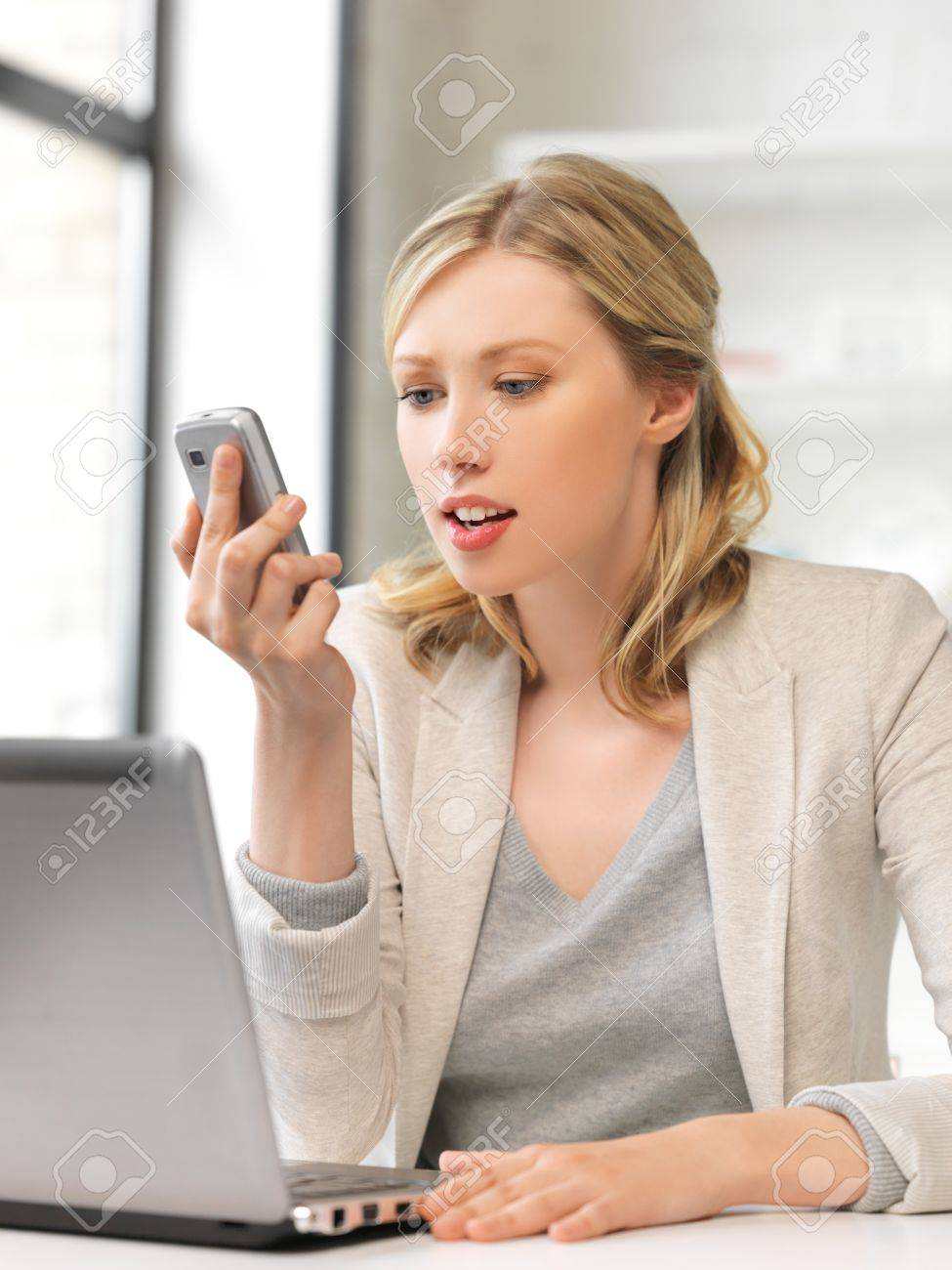 bright picture of businesswoman with cell phone Stock Photo - 14464820