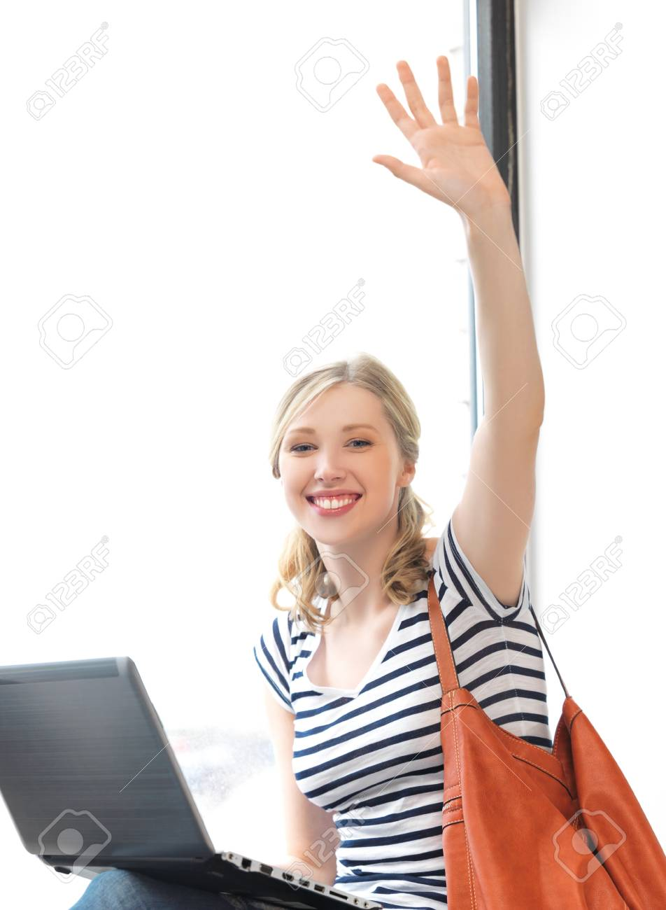 happy teenage girl waving a greeting with laptop Stock Photo - 14529509
