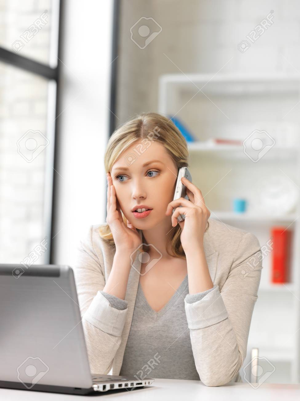 bright picture of businesswoman with cell phone Stock Photo - 14730531