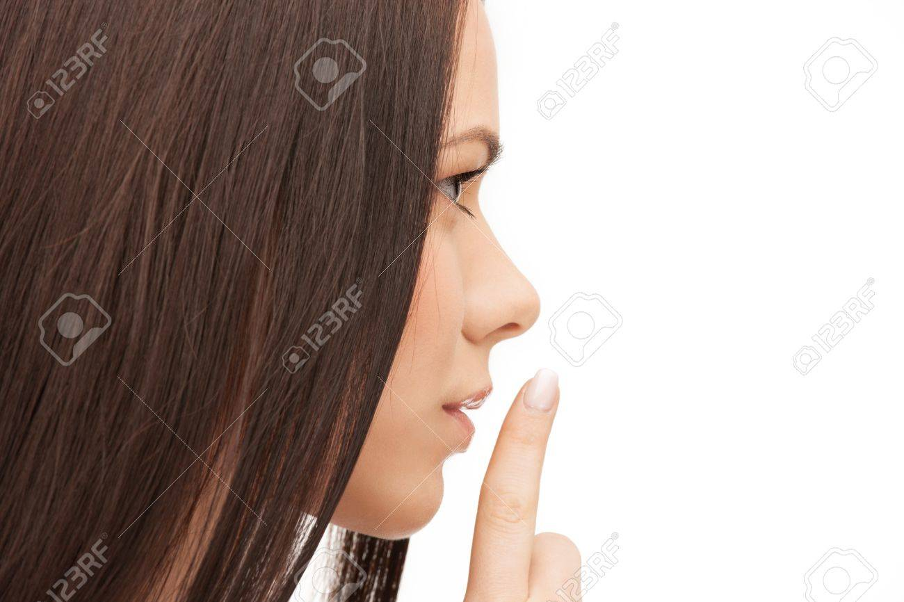 bright picture of woman with finger on lips Stock Photo - 14730406