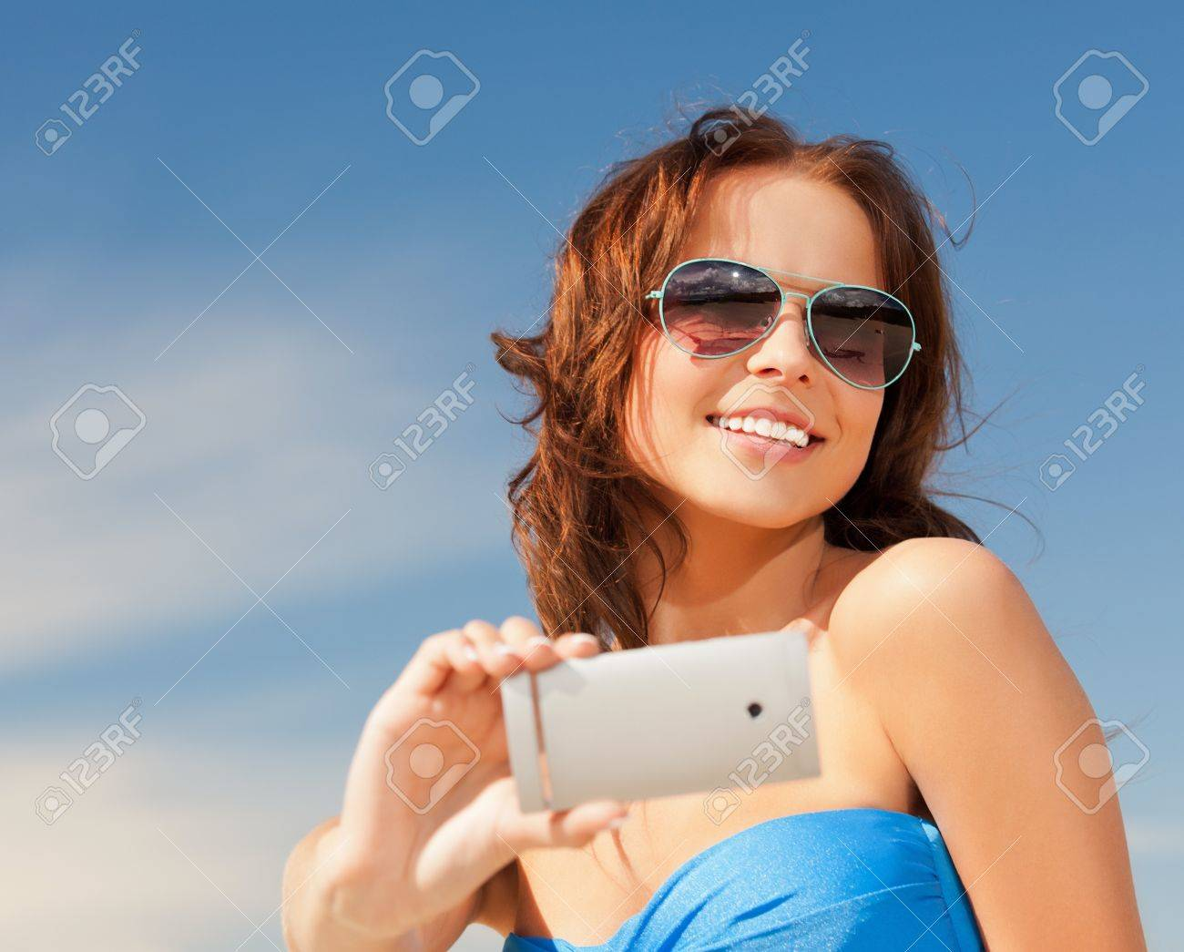 picture of happy smiling woman using phone camera Stock Photo - 14759809
