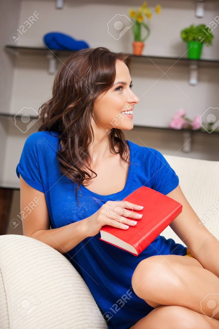 bright picture of happy and smiling woman with book Stock Photo - 15259820