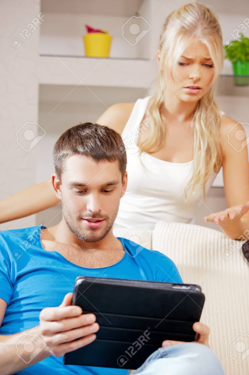 bright picture of couple with tablet PC Stock Photo - 15446017