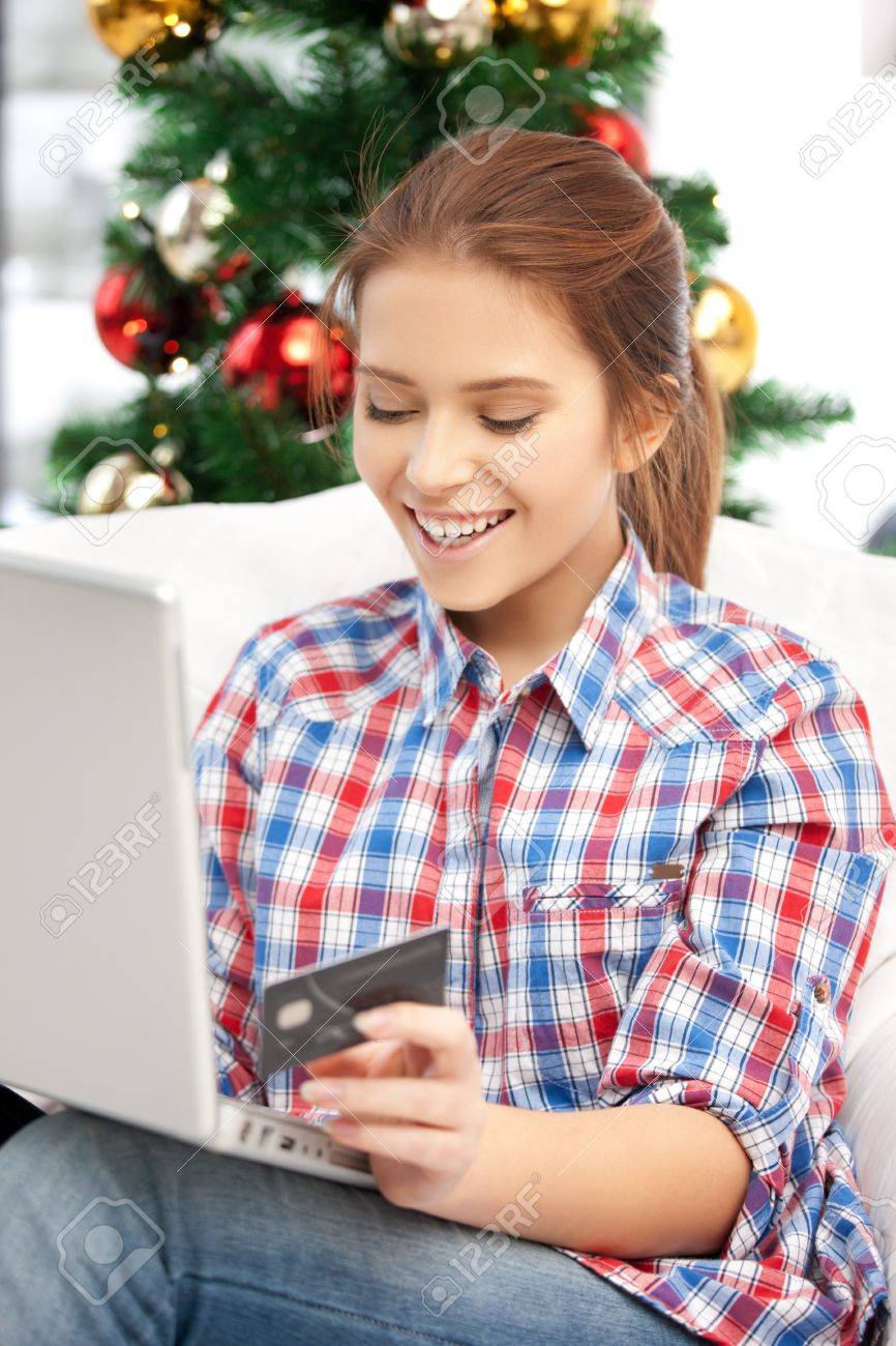 happy woman with laptop computer and credit card over christmas tree Stock Photo - 15452182
