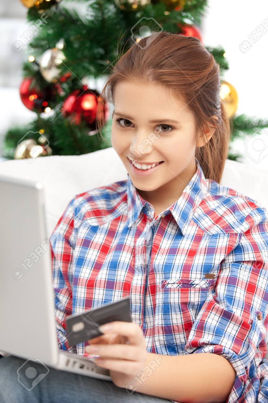 happy woman with laptop computer and credit card over christmas tree Stock Photo - 15575132