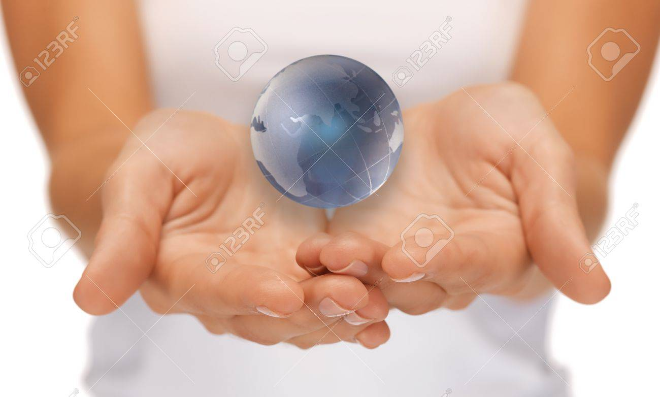 bright closeup picture of woman hands holding earth globe Stock Photo - 15618718
